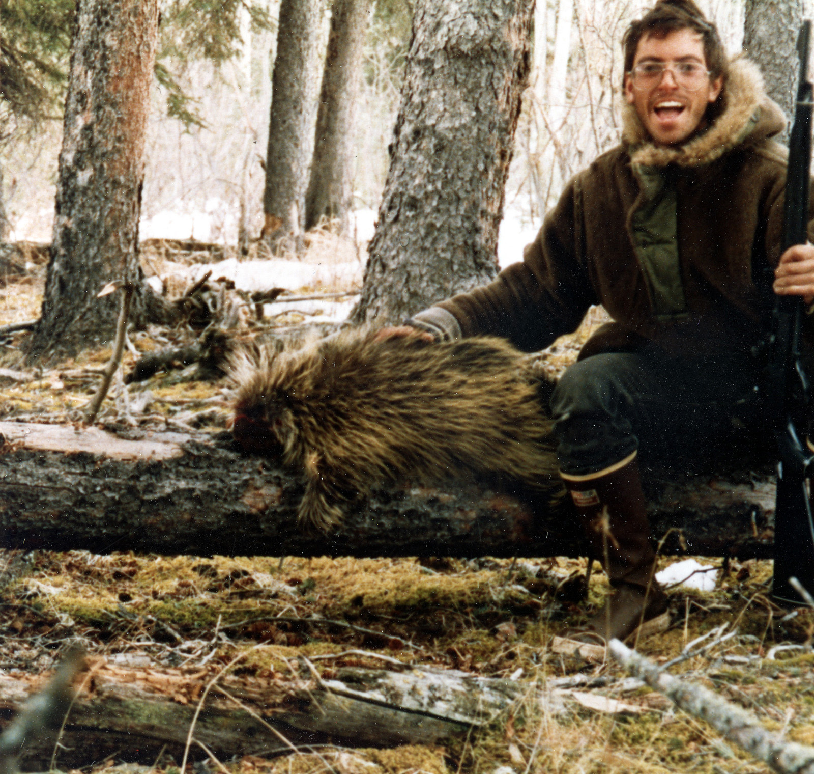 "**FILE** This undated photo provided by the Villard-McCandless family shows Chris McCandless, 24, posing for a self-portrait with a porcupine. McCandless, who hiked into the Alaska wilderness in April 1992 died in there in late August 1992, was apparently poisoned by wild seeds that left him unable to fully metabolize what little food he had. Sean Penn's movie ""Into the Wild"" and Jon Krakauer's book of the same name is causing people from all over the world to retrace McCandless's steps to 1940s-era International Harvester bus near Healy, Alaska where his body was found. (AP Photo/Villard-McCandless family) **NO SALES**"